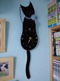 黒ネコの時計